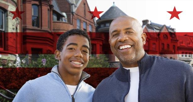 Smiling man and teenage boy