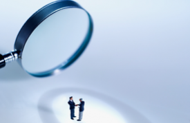 Photo of magnifying glass over two people